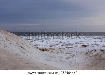 Winter coastal landscape with ice and snow on the beach. Gulf of Finland, Baltic Sea, Russia - stock photo