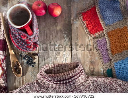 Winter composition with a mug of hot mulled wine, a sweater and a blanket - stock photo
