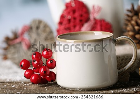 Winter composition with hot beverage on nature background - stock photo