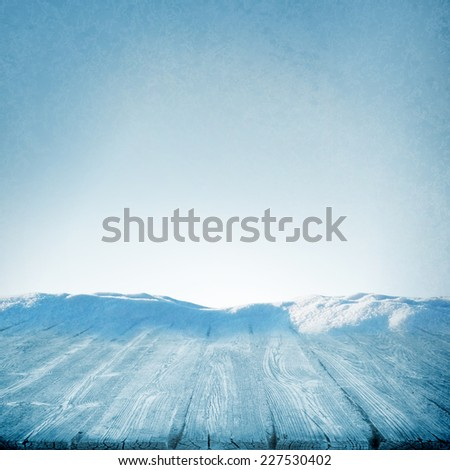 Winter concept of wooden frozen table or path in snow sunny day - stock photo