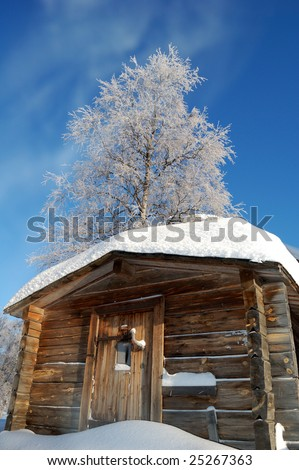 winter cottage where men have lived and worked - stock photo