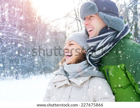 Winter couple. Happy Couple Having Fun Outdoors. Snow. Winter Vacation. Outdoor  - stock photo