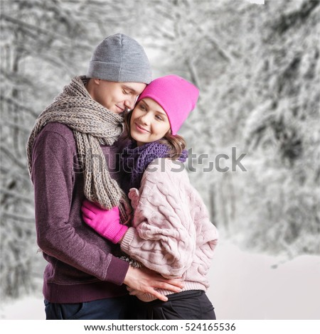 Winter couple. Happy Couple Having Fun Outdoors. Snow. Winter Vacation. Outdoor .