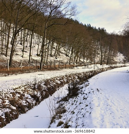 Winter creek. Beautiful natural winter background in the valley with a stream. Seasonal background - winter. Brno - Czech Republic. - stock photo