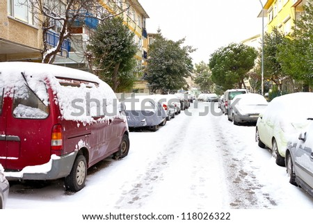 Winter day with parked cars trapped under snow in Istanbul - stock photo