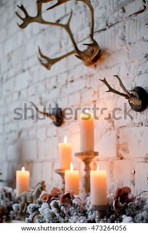 winter decor with candles and horns