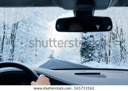 winter driving - country road in winter - stock photo