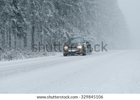 Winter driving - country road in winter - risk of snow and ice
