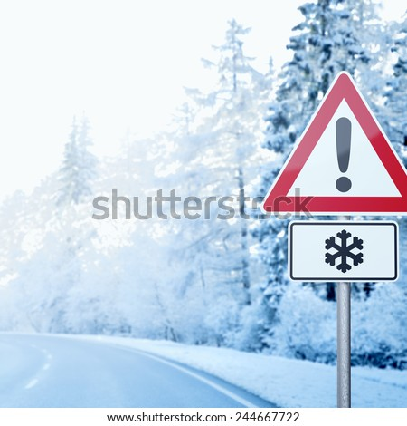 Winter Driving - Curvy Winter Road with Warning Sign - stock photo