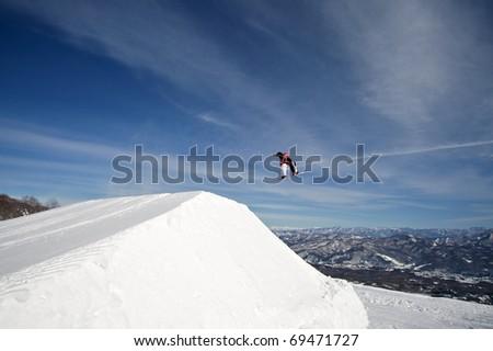 Winter extreme sport snowboarder - stock photo