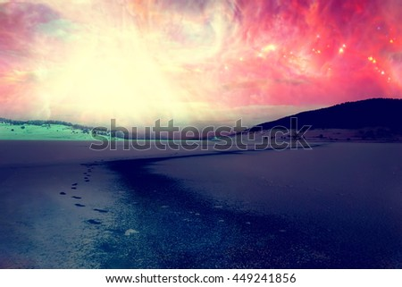 winter fairy landscape with lake covered in ice, abstract alien sky with manny stars- elements of this image are furnished by NASA - stock photo