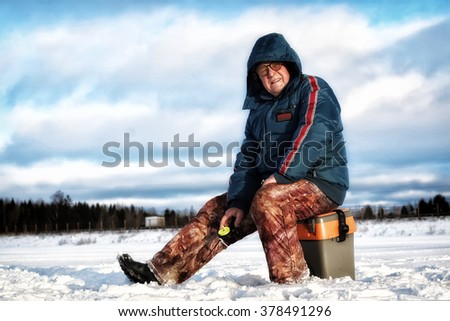 Winter Fisherman on the Lake