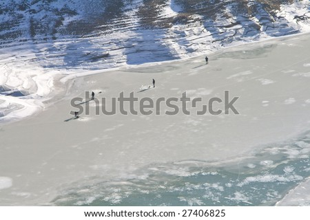 winter fishing on the riverside - stock photo