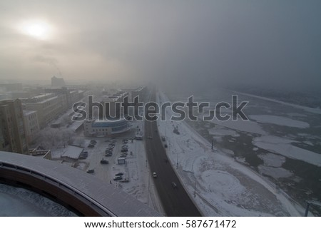 Winter foggy embankment in Russia, Omsk