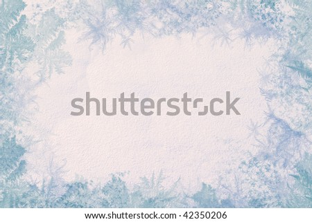 Winter frame. Consists of the texture of snow in the center and the edges of the ice patterns. Cool colors and low contrast. - stock photo