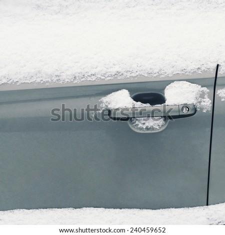 Winter freezing car, frozen handle door vehicle in the snow  - stock photo