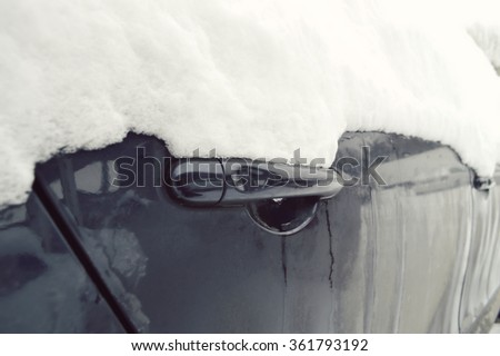 Winter freezing car, frozen handle door vehicle in the snow - stock photo