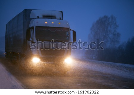 Winter freight transportation by truck - stock photo