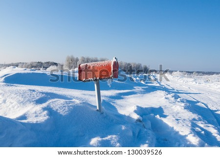 winter frozen mail box under snow - stock photo