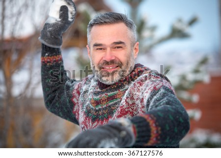 Winter fun man happy smiling and throwing snowballs. Winter fun, winter holiday, winter vacation - stock photo
