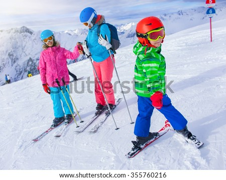 Winter fun, skiing - little boy with his family ski team - stock photo