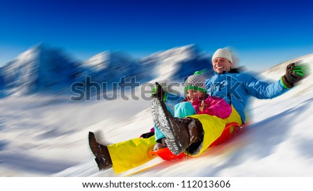 Winter fun -  sledding at winter time - stock photo