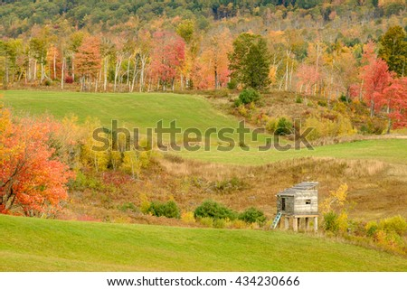 Winter game and food storage cache built on stilts on a Maine Mountainside to keep food fresh and away from predators - stock photo