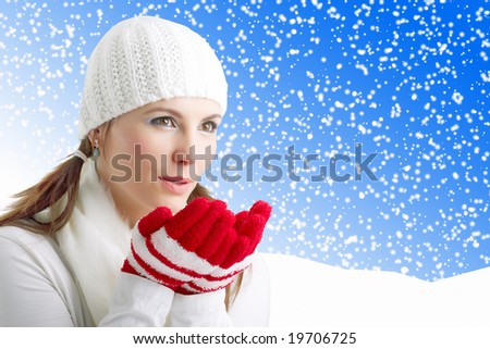 Winter Girl blowing snowflakes, blue background