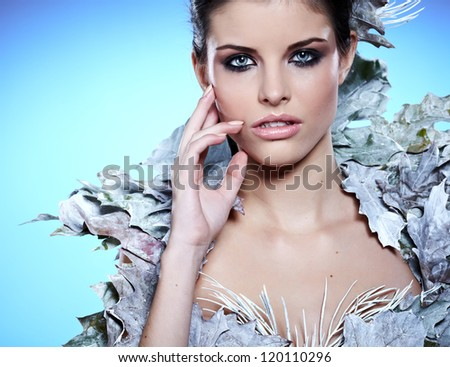 Winter Girl in Luxury fantasy Coat - stock photo
