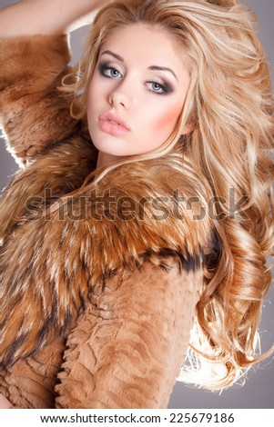 Winter Girl in Luxury Fur Coat. Fashion Fur, vogue style model, beauty woman bright makeup and long blond hair. series - stock photo