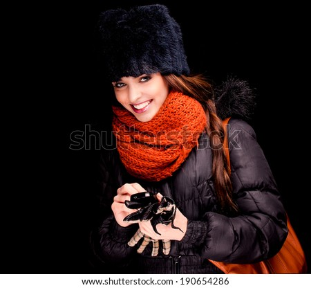 winter girl on the black background - stock photo