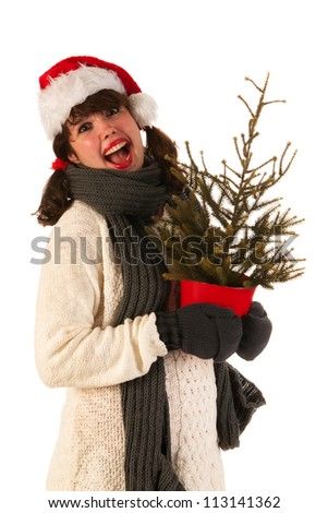 Winter girl with wool sweater and hat of Santa Claus