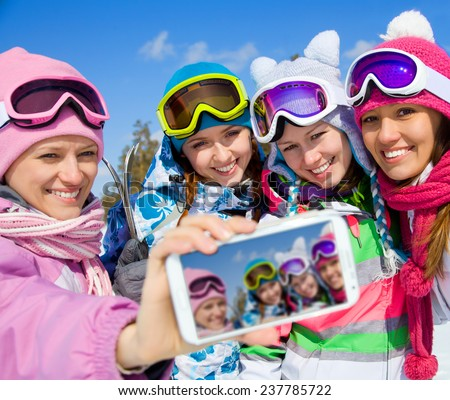 winter group of young woman  salfy in ski resort - stock photo