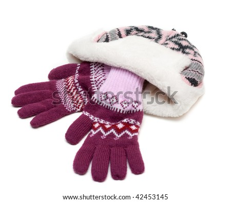 Winter hat with fur and violet gloves on white background - stock photo