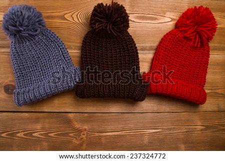 Winter hats with tassel - stock photo