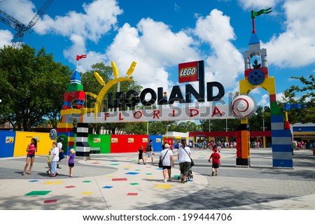 WINTER HAVEN, FL - June 18, 2014: Visitors pass through the entrance to Legoland Florida in Winter Haven, FL, on June 18, 2014. - stock photo