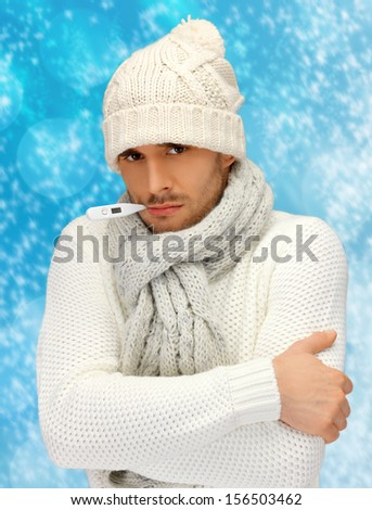 winter, health, medicine concept - sick man with thermometer in his mouth