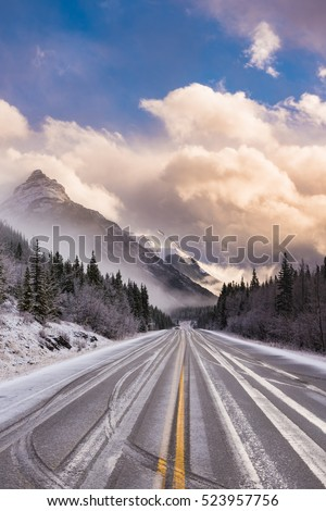 Winter highway driving through a storm on a  mountain pass, Alberta Canada