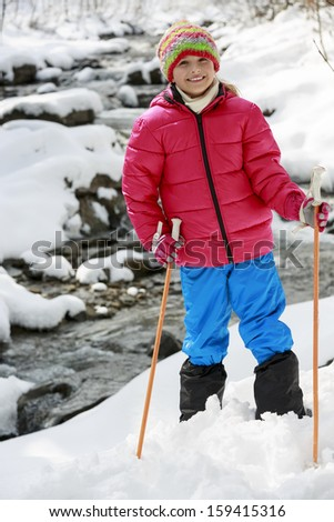 Winter hike -  young girl in winter mountains - stock photo