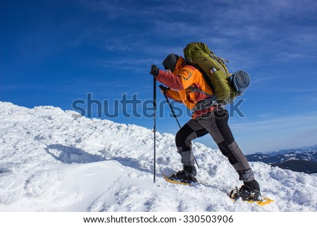 Winter hiking in the mountains on snowshoes .  - stock photo