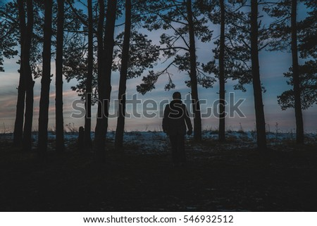 winter hiking sunset alone