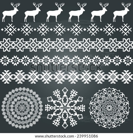 Winter holiday set in white color on chalkboard background. Deer and snowflakes borders, ethnic borders and round patterns. Could be used for web, cards, decorations, etc. Raster version  - stock photo