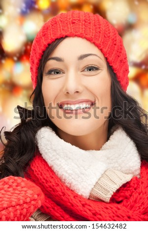 winter, holidays, christmas concept - beautiful woman in hat, muffler and mittens - stock photo