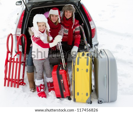 Winter holidays, ski, travel - family with baggage ready for the travel for winter holidays - stock photo