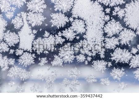 Winter ice crystals on window glass, macro closeup. - stock photo