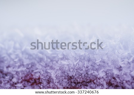 Winter iced blue pattern with snowflakes, holiday seasonal background - stock photo