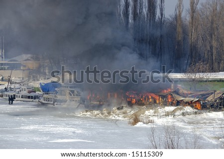 Winter ignition of warehouse structures. - stock photo