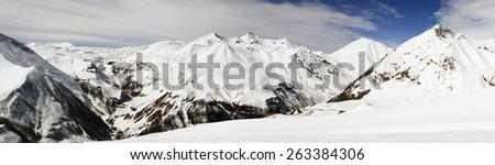 Winter in mountain range. Caucasus mountains panoramic view. - stock photo