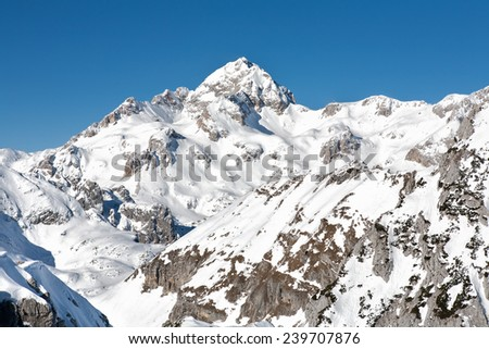 Winter in mountains. Photo of beautiful scene in European Alps. View from Visevnik (2050 m) towards highest peak of Slovenia, Triglav (2864 m).  - stock photo