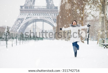 Winter in Paris. Happy young girl jumping